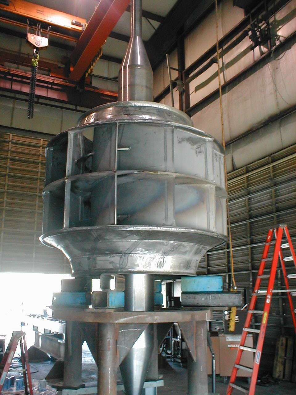 Installation of new machined shaft in fan wheel