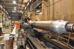 Machining large shaft lathe.