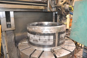 King vertical CNC machining center with babbitt bearing being machined.
