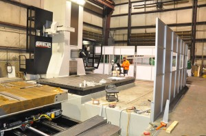 Large machining center calibration with laser tracker
