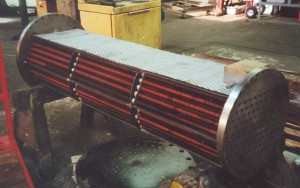 Tube bundle manufacture in pressure vessel heat exchanger.
